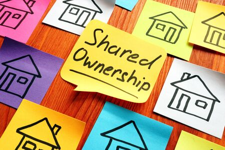 Photo pour Shared ownership phrase and drawn houses. - image libre de droit