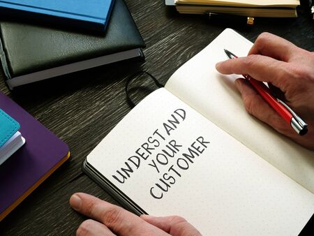 Photo for Businessman writes Understand your customer in the notepad. - Royalty Free Image