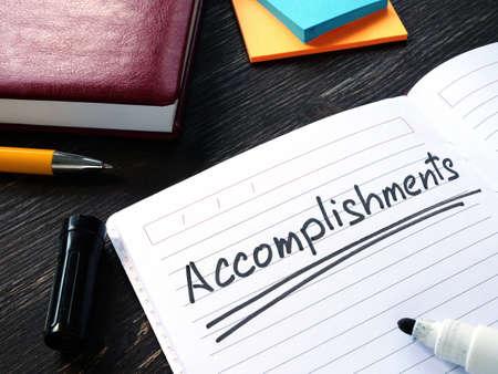 Photo pour Accomplishments list in the notebook on the desk. - image libre de droit