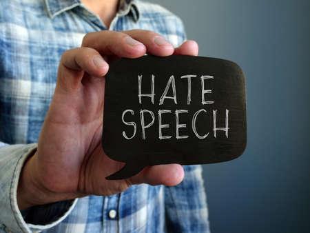 Photo pour Hate speech concept. A hand holds a black plate. - image libre de droit