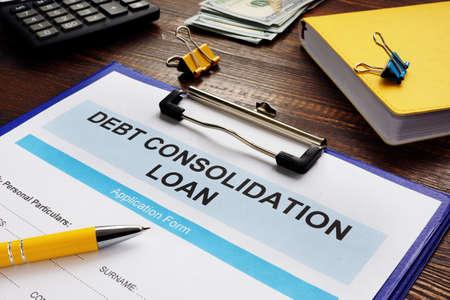 Foto de Debt consolidation loan form, notepad and calculator. - Imagen libre de derechos