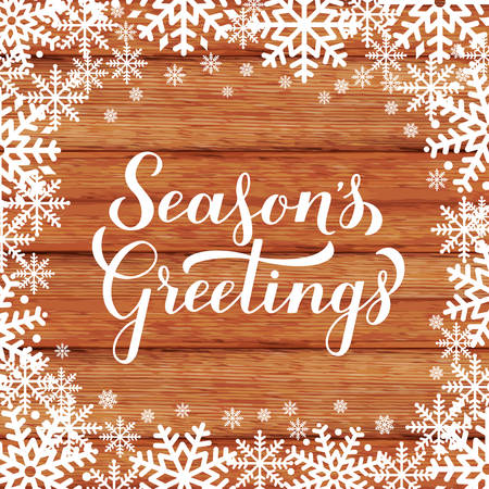 Illustration pour Season s Greetings calligraphy hand lettering on wood background with snowflakes. Merry Christmas and Happy New Year typography poster. Vector template for greeting card, banner, flyer, tag, etc. - image libre de droit