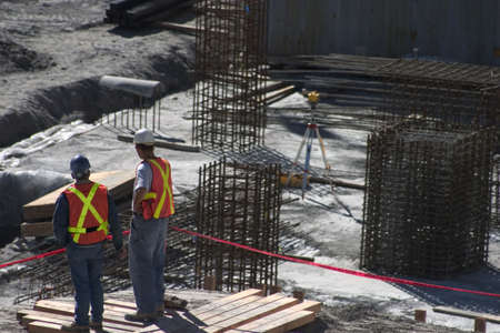 Building site and two construction workers