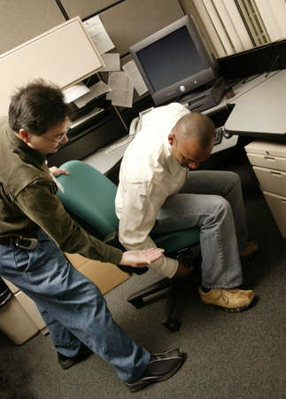 An occupational therapist working with a client