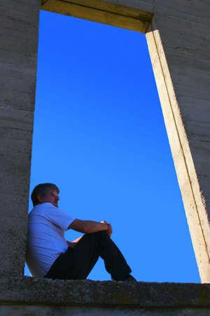 Man sitting on open ledge