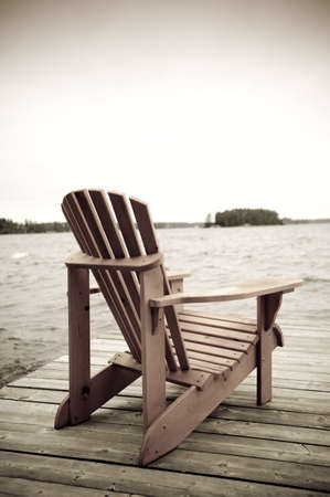 Adirondack chair on deck, Muskoka, Ontario, Canada