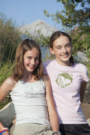 kananaskis country, alberta, canada; two girls together in the mountains