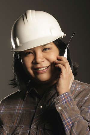 Aboriginal female site worker on cell phone