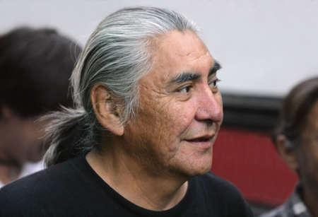 Senior man with long gray hair