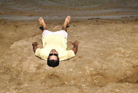 Man laying on beach