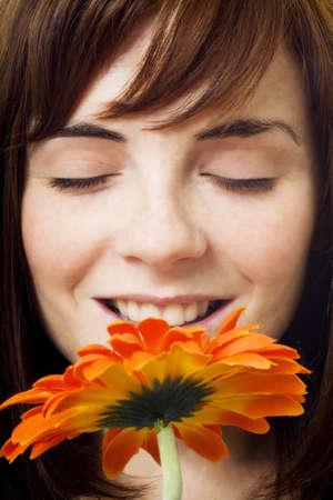 Women enjoying smell of flower