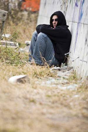 Man beside graffiti