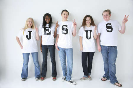 Five teenagers with t-shirts spelling Jesus