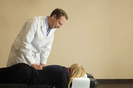 Chiropractor with his patient