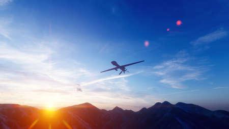 Photo pour A military drone flies over a desert mountain plain at sunset. - image libre de droit