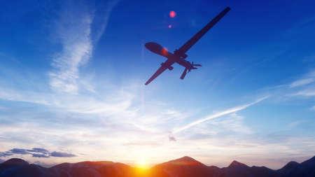 A military drone flies over a desert mountain plain at sunset.