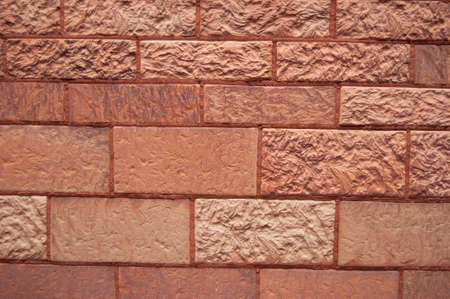 A detailed view of an old red brick wall