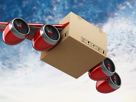 Foto de Air mail concept with cardboard having wings and jet engines. - Imagen libre de derechos