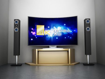 Ultra HD Curved TV with home theater system in the room