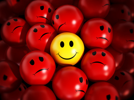Photo for Yellow smiling face stands out against red spheres. - Royalty Free Image