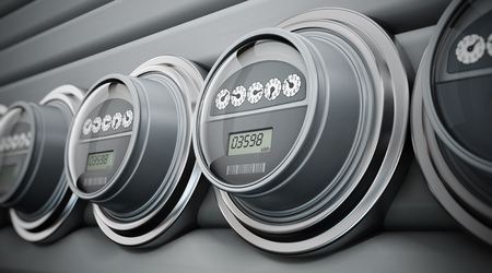 Gray electric meters standing in a row
