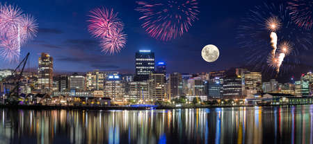Wellington harbor cityscapes with full moon and fireworks