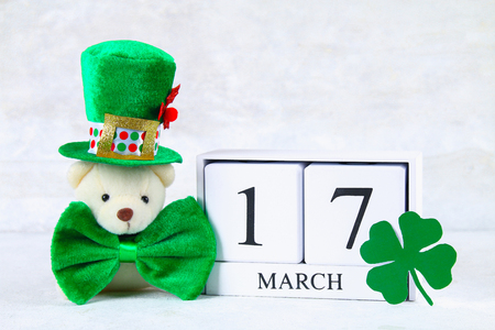 St.Patrick 's Day. A wooden calendar showing March 17. Green hat and bow