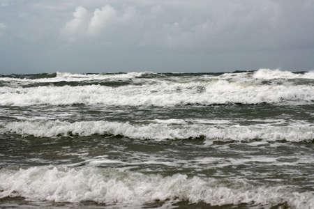 north sea waves crashing to shore along coastline