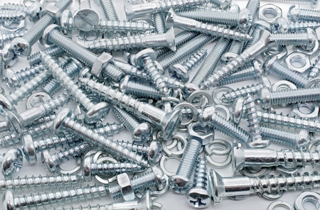 Macro Shot of A Big Collection Of Iron Screws, Nuts and lockwashers