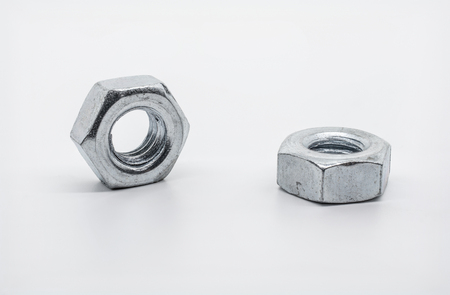 Macro shot of Two Lying Iron Nuts