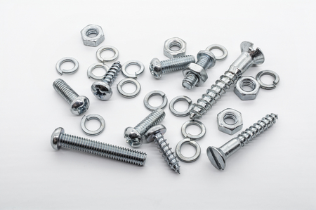 Macro Shot of A Small Collection Of Iron Screws, Nuts and lockwashers