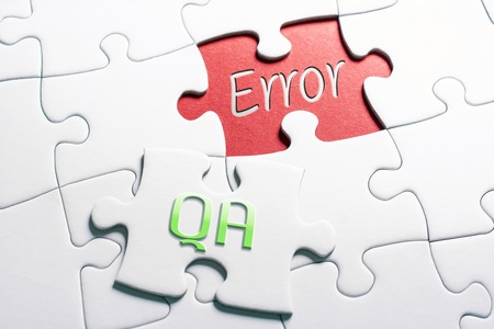 Photo pour The Words QA And Error In Missing Piece Jigsaw Puzzle - image libre de droit