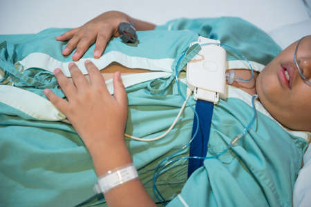 Foto de Asian boy wearing Sleep Apnea Diagnostic medical device Kit. Sleep Lab Test. - Imagen libre de derechos