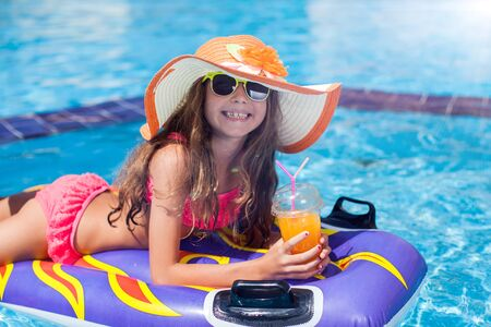 Photo for Kid girl in the pool has fun. Children and summer concept - Royalty Free Image