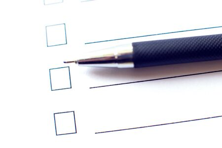 Photo pour Checklist with a pen on white paper. Checkbox concept. - image libre de droit