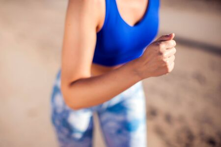 Woman with short blond hair running outdoor. Close up. People, fitness and healthcare concept
