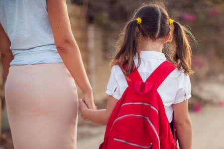Photo pour Back to school. Parent care concept. Pupil and mother going to school. - image libre de droit