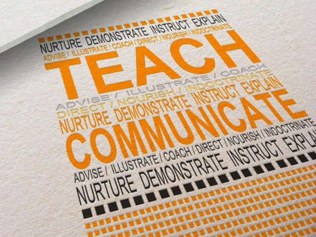 The word Teach letterpressed into paper with associated words around it.
