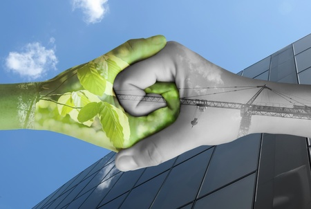 Photo pour Two hands ecology. Nature and industry together - image libre de droit