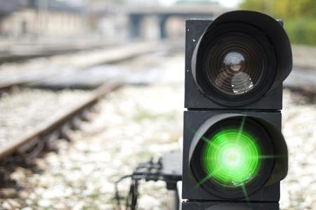 Traffic light shows red signal on railway. Green light