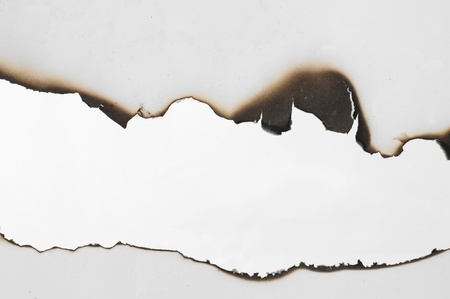 Burned paper and close up hole