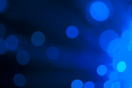 Blue and green festive lights and circles background. Blurred christmas lights