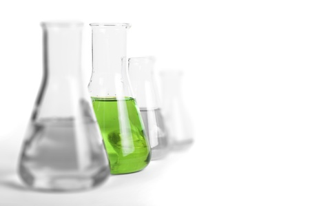 Laboratory glassware equipment. Laboratory beakers filled with colored liquid substances
