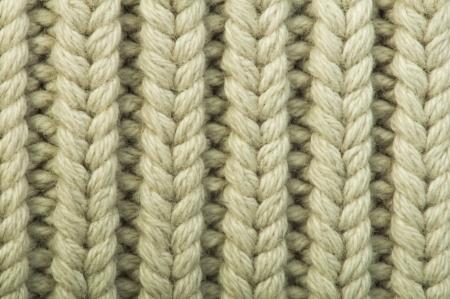 Photo pour Old knit sweater background. Beige color. Studio shot - image libre de droit