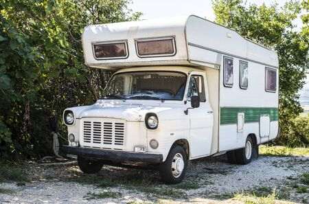 Photo for Old white camper bus. Vintage van. Tourism nostalgy concept with old vehicle. - Royalty Free Image