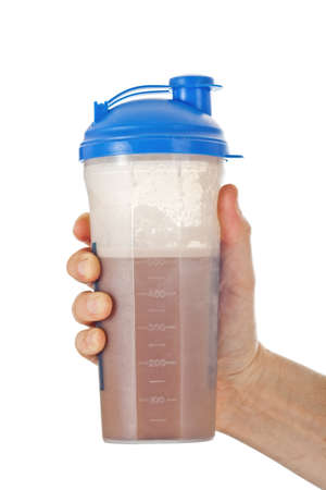 Man's fist holding the post workout chocolate whey protein shake, ready to drink it, isolated on white