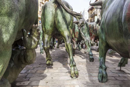 The Statue of Encierros in Pamplona, Spain. The statue was created by Rafael Huerta in 1994 in commemoration of the internationally known Pamplona Bull Run.