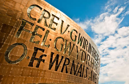 Wales Millenium Centre hosting welsh opera and arts center. The face of the building is emphasised by a spectacular set of windows, made in the form of letters, that read together as a poem.