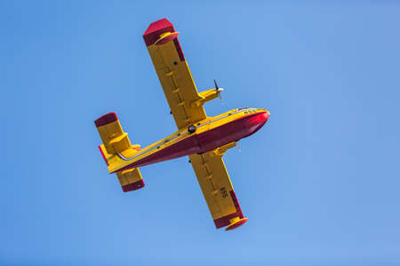 ZAGREB, CROATIA - AUGUST 4, 2015: Bombardier 415 Superscooper formerly Canadair CL-415 SuperScooper flying during Zagreb military parade. It's a Canadian amphibious aircraft purpose-built as a water bomber.