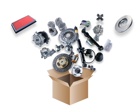 Many spare parts flying out of the box on white background